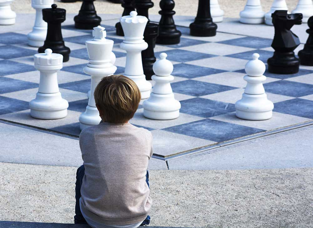 Families and Kids play chess in the library